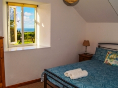 Double bedroom with countryside & sea views